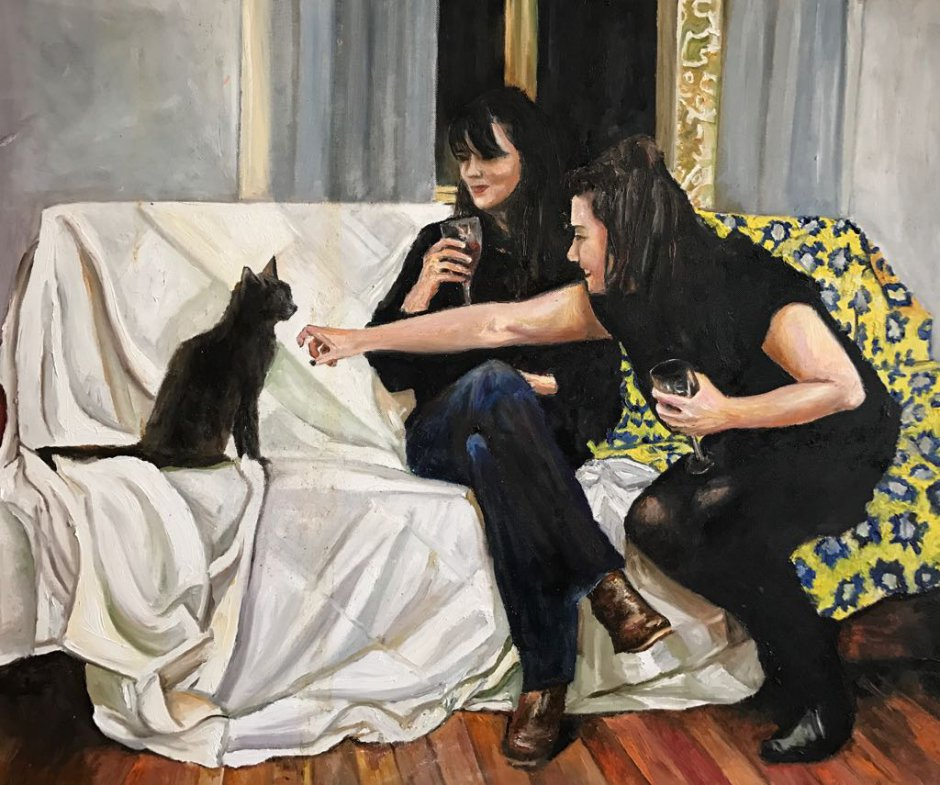 Two sisters with Bacon the cat